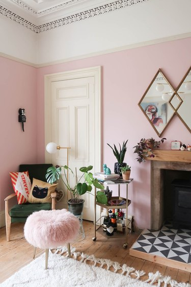 pink living room color idea with glamorous styling
