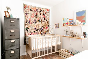 baby nursery idea with light wood furniture and industrial filing cabinet