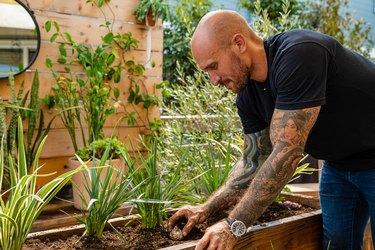 man planting bulbs in garden