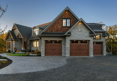 craftsman style garage doors with windows and warm wood finish