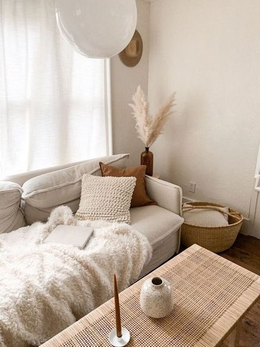 beige living room color idea with bohemian details