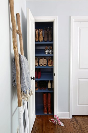 Slim Shoe bedroom closet idea by Hunted Interior with blue tilted shelving