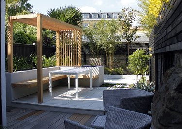 Downsized wood contemporary pergola on deck next to palm trees