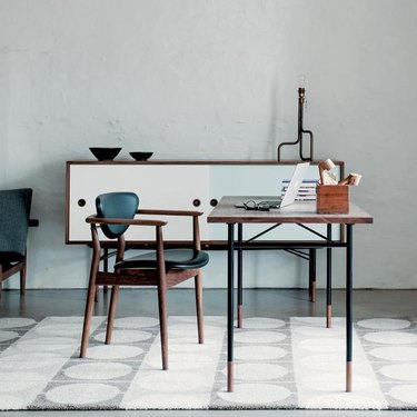 office space with white rug and blue chair