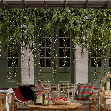 Christmas decorations list for outdoor setting with greenery and string lights