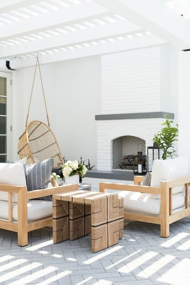 White contemporary pergola with sunlight and modern furniture