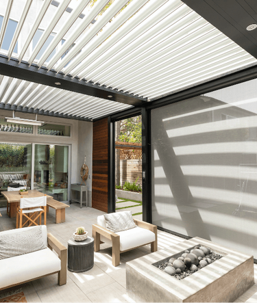 Linear contemporary pergola in black and white with modern furniture and outdoor fireplace