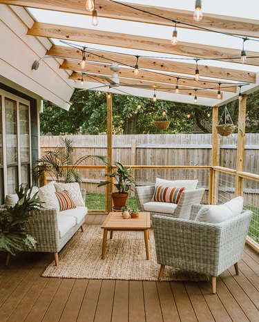 Angled wood contemporary pergola on deck with outdoor furniture