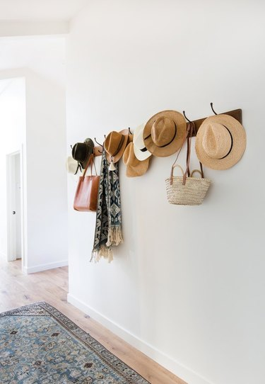 hallway with hanging hats