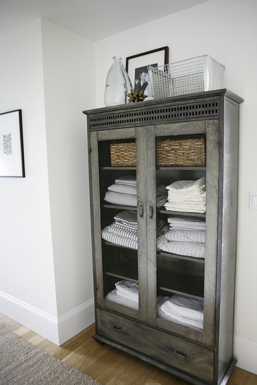 linen closet organization with cabinet filled with linens