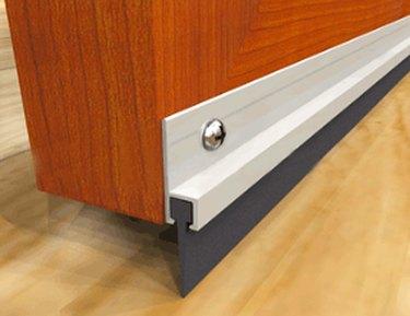 Metal and rubber door sweep.