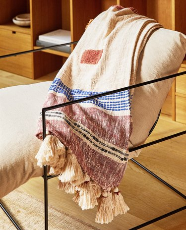 chair with throw blanket with tassels