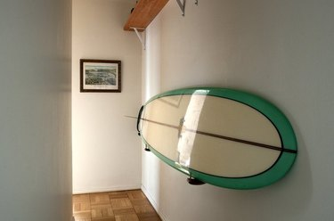 hallway with surfboard on the wall