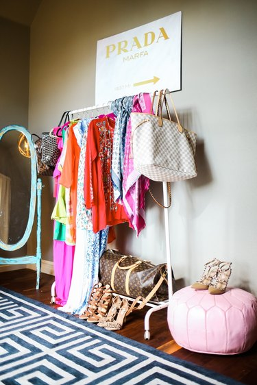 Purses hanging off a clothing rack