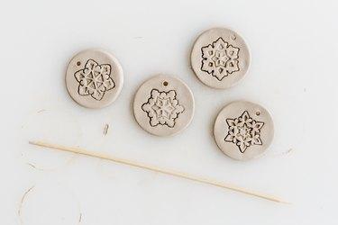 Poke holes through the clay.