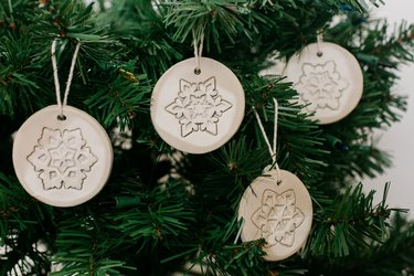 These DIY Stamped Air Dry Clay Christmas Ornaments are the perfect minimalist holiday décor.