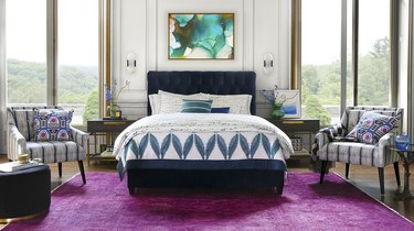 mixed pattern bedroom with purple rug