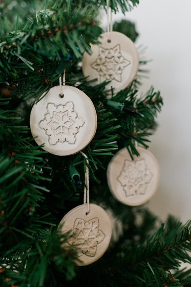 Hang your finished clay ornaments on the tree.