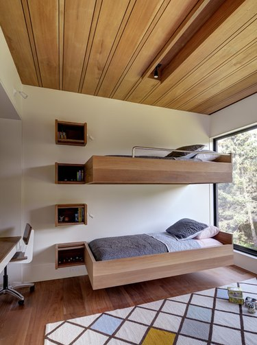 midcentury bedroom with floating bunk beds and wood ceiling