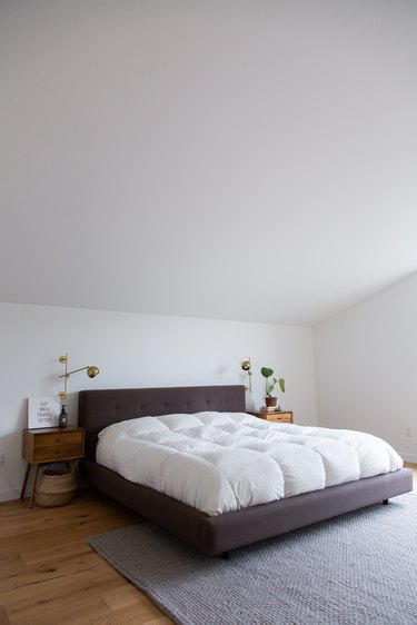Bed in bedroom with high ceilings - The Modern Edit
