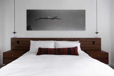 Bed with lumbar pillow and wood headboard