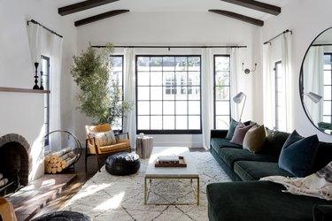 living room with dark green velvet sectional