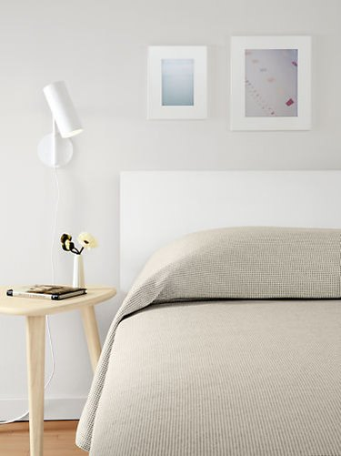 midcentury bedroom lighting idea with wall scone on wall next to bed