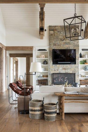 Living Room lighting idea in rustic space with wood beams