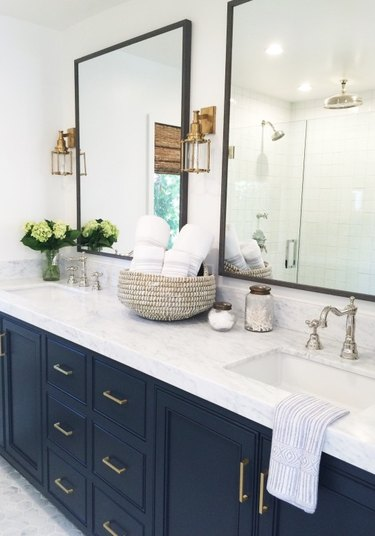 marble bathroom countertop with blue cabinets
