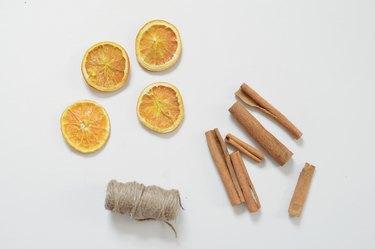 dried orange with cinnamon sticks and string