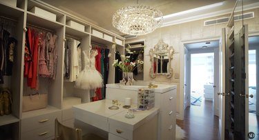misty copeland's closet with chandelier and vintage mirror
