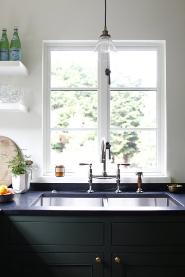 deck-mounted kitchen faucet with stainless steel kitchen sink