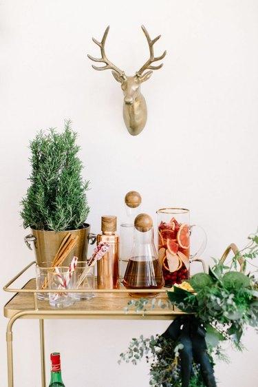 rosemary plant on a brass bar cart