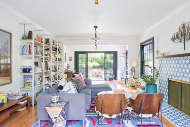 colorful living room with patterned tile fireplace