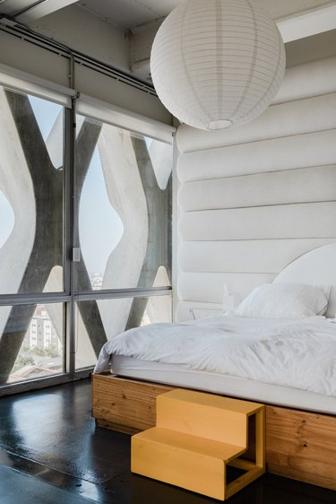 Loft bedroom with white fabric walls
