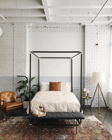 modern bedroom lighting idea with modern floor lamp and four poster bed