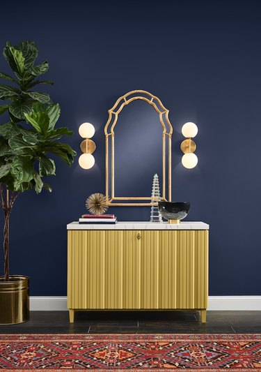 entryway with navy walls and credenza