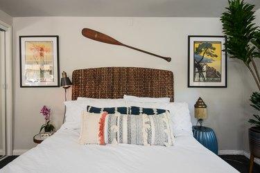 Bedroom with oar over the headboard