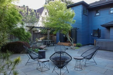 blue colonial house outdoor patio