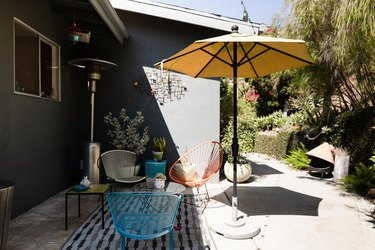 patio with umbrella and colorful furniture
