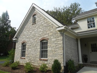 Faux stone siding on addition.