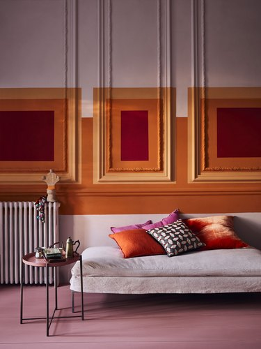 pink and orange color blocked walls in living room