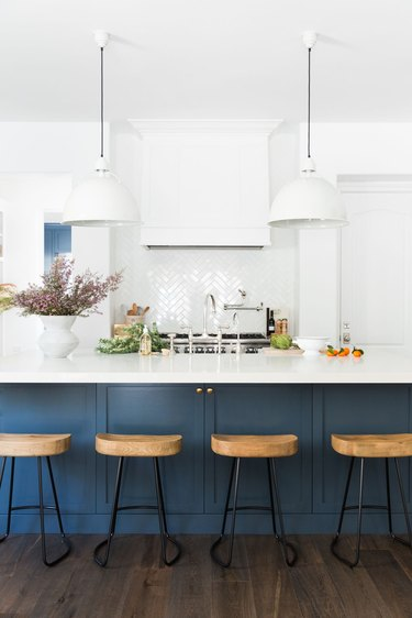 navy kitchen island with marble top