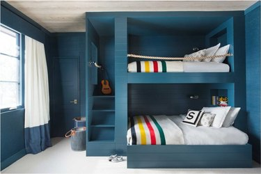 nautical theme blue bedroom with bunk beds