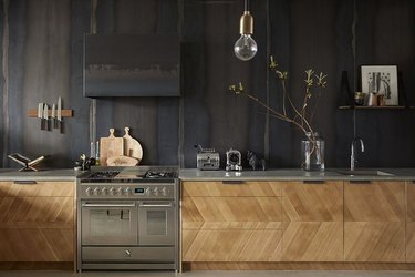 industrial design with stainless steel kitchen appliances and wood cabinets