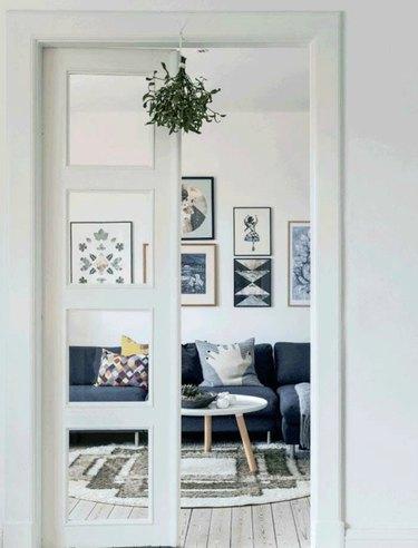 minimalistic white scandinavian interior with mistletoe