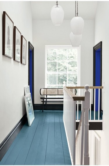 white hallway with green painted wood floors