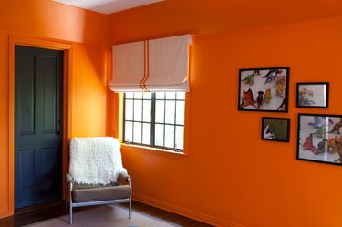 orange bedroom with black door