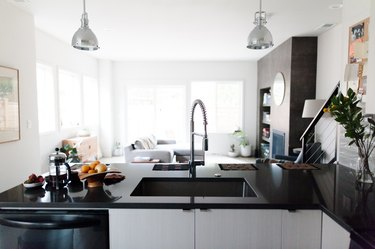 undermount kitchen sink and kitchen faucet with black countertops