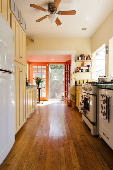 kitchen space in craftsman house with orange and yellow paint